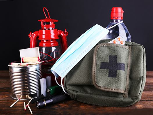 Lantern, water, flashlight, first aid kit in backpack