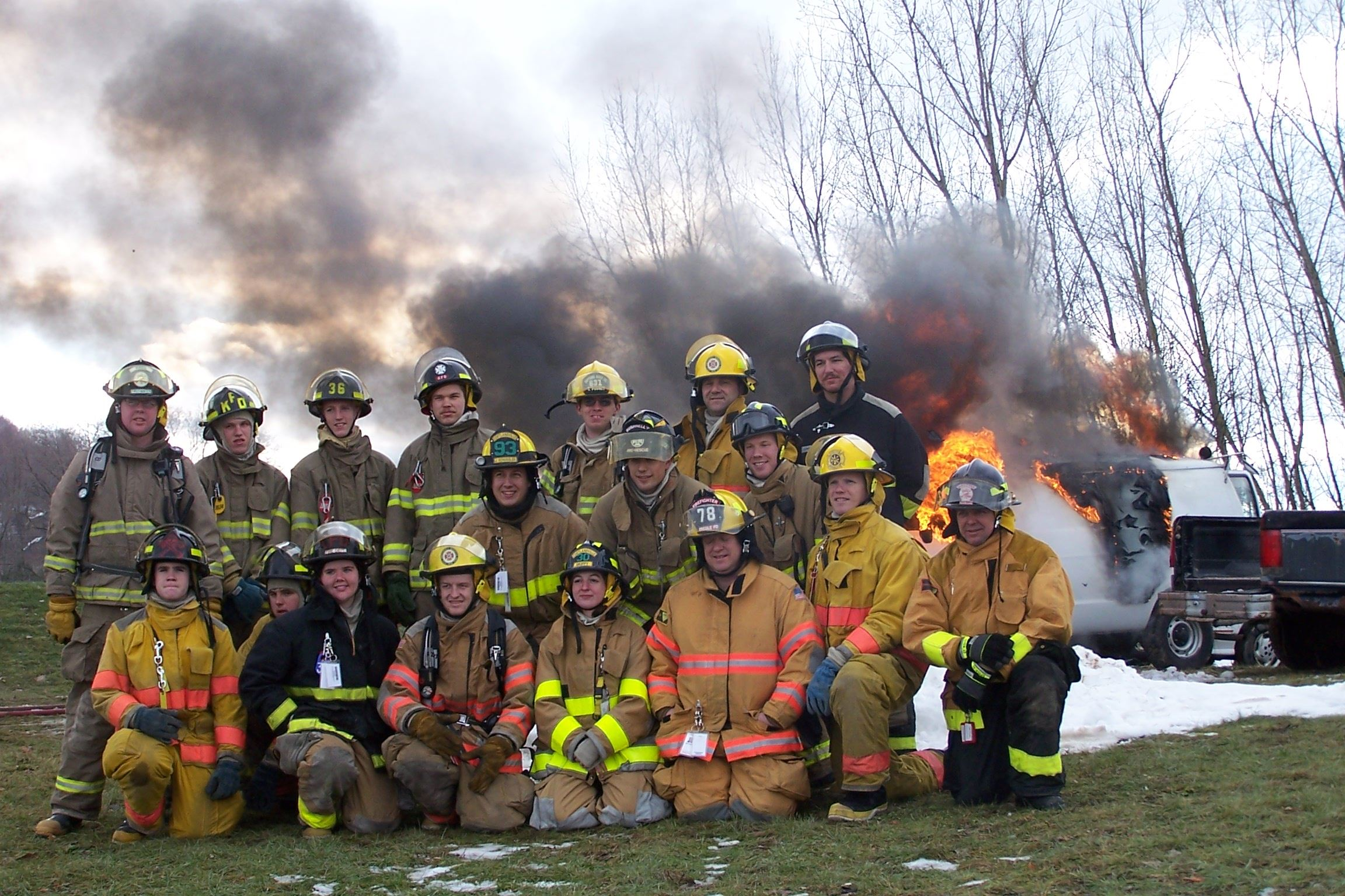 A group of firefighters pose for a picture after a car fire training.